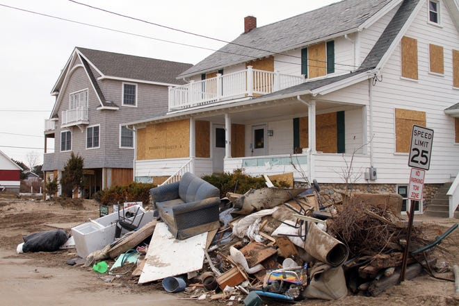 More than a month after Superstorm Sandy ravaged Westerly in 2012, residents were still cleaning up along Atlantic Avenue near Misquamicut State Beach.