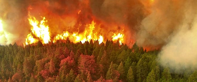 French Fire roars through pine forest in view from Shirley Peak on Friday.
