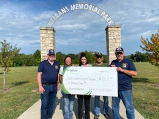 Michelle Slone, of Infuze Credit Union of Rolla, flanked by members of the park committee, pictured left to right, Andy Davis, Felecia, Kenny Cale and Glenn Gibson.