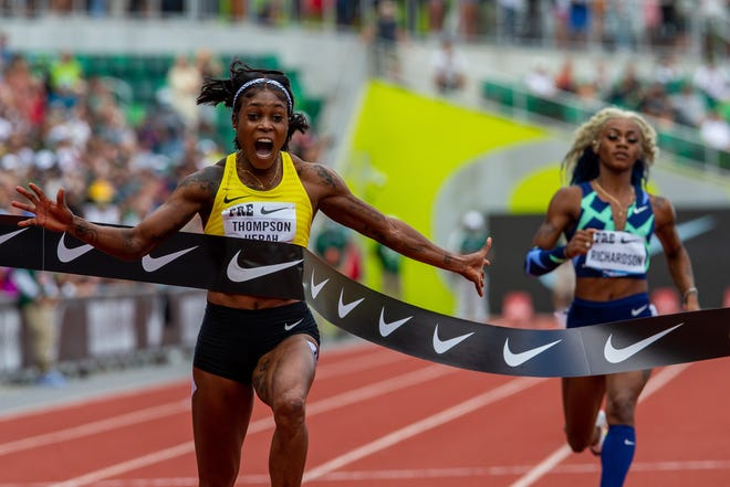 Jamaica's Elaine Thompson-Herah wins the 100 meters in 10.54 at at the 2021 Prefontaine Classic at Hayward Field in Eugene, Ore., on Saturday, Aug. 21, 2021. USA's Sha'carri Richardson, right, finished last.