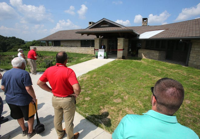 People gathered Saturday for the grand opening of the Harold S. Fry Visitor Center at Fry Family Park in Pike Township.