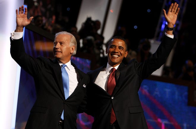 Democratic presidential candidate Sen. Barack Obama, D-Ill., right, and Democratic vice presidential candidate, Sen. Joe Biden, D-Del., are seen at the Democratic National Convention in Denver on Aug. 27, 2008.
