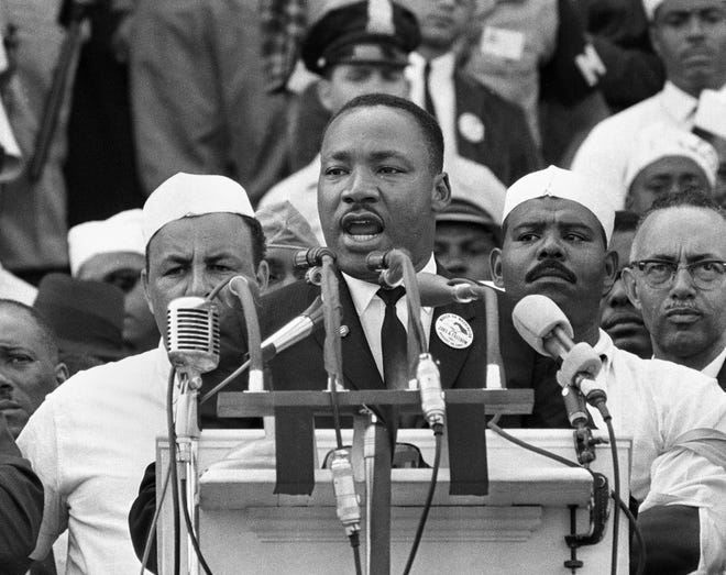 """In this Aug. 28, 1963 photo, Dr. Martin Luther King Jr., head of the Southern Christian Leadership Conference, addresses marchers during his """"I Have a Dream"""" speech at the Lincoln Memorial in Washington."""