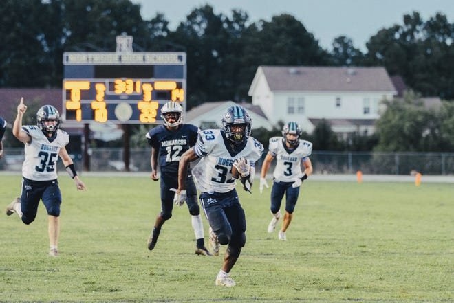 Hoggard running back Sam Williams breaks away from the defense for a rushing touchdown during the Vikings' 28-0 win over Northside Friday.