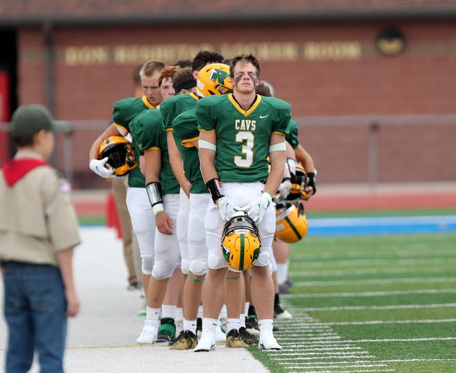 Aberdeen Roncalli running back Maddox May reflects ahead of the season opening game against St. Thomas More on Aug. 20 at Swisher Field. American News photo by Jenna Ortiz, taken 08/20/2021.