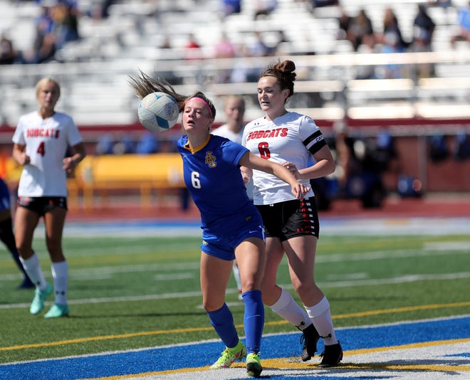 Aberdeen Central midfielder Morgan Fiedler tries to get to the ball before Brookings defender Claire Burns during the first half at Swisher Field. American News photo by Jenna Ortiz, taken 08/21/2021.