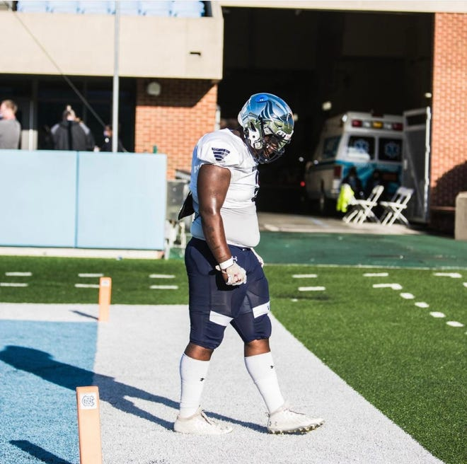 Five-star 2022 Grimsley defensive tackle Travis Shaw warms up ahead of the Whirlies' NCHSAA 4-A state championship game against Cardinal Gibbons in Kenan Stadium on May 7. Shaw verbally committed to the Tar Heels on Aug. 21, giving UNC another highly touted recruit on its defensive line.