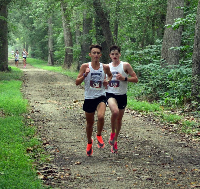 Iggy Chalker, left, and Henry Schmidt share the lead at the 2-mile mark Saturday morning at the Gary Brown Memorial C&O Canal 5-Mile Run.