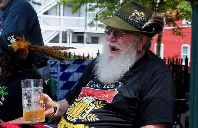 """Frank Kronawetter of Hagerstown gets the celebration going early at the start of the Downtown Plaza Festival at University Plaza on West Washington Street on Saturday. Hagerstown is rich in German heritage and the city has typically been the site of Augustoberfest to celebrate the history. But Saturday's celebration was scaled down to a one-day event due to the COVID-19 pandemic. The event featured the usual German-style offerings like live music, bratwurst, hot dogs, sauerkraut, and of course, cold beer, in addition to other drinks. Kronawetter said his grandfather came to the U.S. from Germany in 1910 and the family eventually settled in Hagerstown for work on the Western Maryland Railroad. """"That's where we've been ever since,"""" said Kronawetter, a retired Maryland Correctional Training Center correctional officer."""