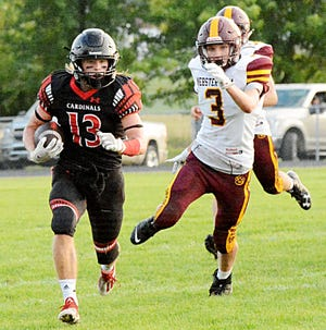 Deuel's Owen Quail (13) breaks away from Webster Area's Jacob Keller on the way to a 37-yard touchdown run during their season-opening high school football game Friday night in Clear Lake. Deuel won 28-3.