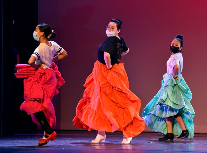 Dancers from St. Vincent Pallotti Catholic Church's Ballet Folklorico rehearse Friday at the Paramount Theatre. The troupe will present two performances at the theater this weekend.