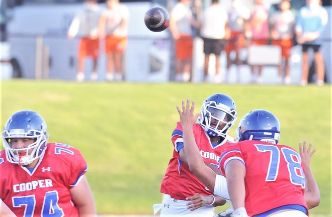 Cooper quarterback Chris Warren throws a pass during the Cougars' scrimmage against San Angelo Central on Friday at Shotwell Stadium.