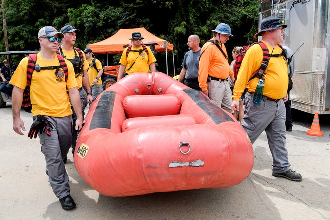 Teams from all over North Carolina assisted in search efforts along the Pigeon River following Tropical Storm Fred August 20, 2021.