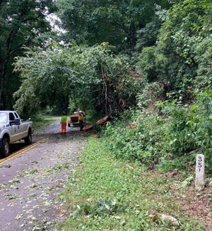 Crews clean up damage from Tropical Storm Fred on the Blue Ridge Parkway.