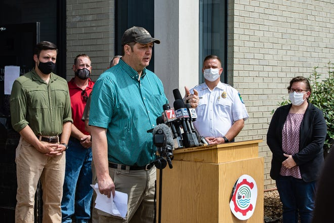 Haywood County Board of Commissioners Chair Kevin Ensley speaks at a press conference with Sen. Thom Tillis in Canton after Tropical Depression Fred on Thursday, August 19, 2021. Ensley tested positive for COVID 19 on Aug. 19.