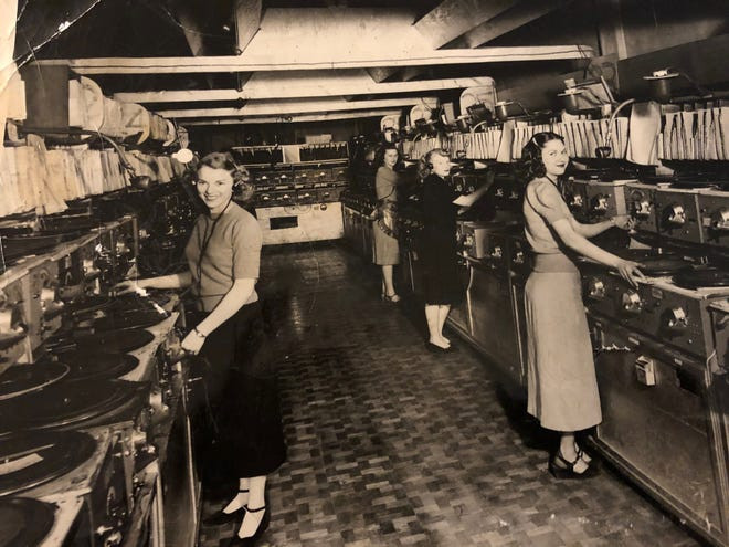 Female DJs working at a multiphone central station in Seattle.