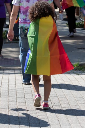 About 100 members of the LGBTQ community and their supporters walked through downtown Chillicothe for a Pride Walk on Saturday. August 21, 2021, in Chillicothe, Ohio.