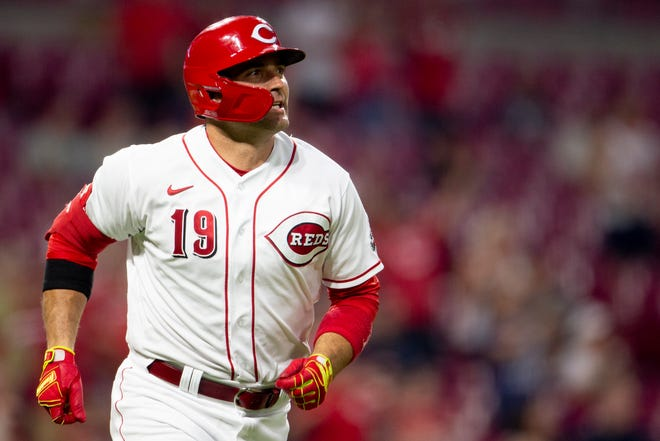 Cincinnati Reds first baseman Joey Votto (19) watches his ball leave the park after hitting a 2-run home run in the fifth inning of the MLB baseball game between the Cincinnati Reds and the Miami Marlins on Friday, Aug. 20, 2021, at Great American Ball Park in Cincinnati.