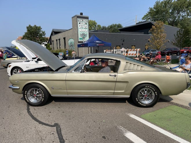 John Cordier of Mogadore, Ohio, in his 1966 Mustang fastback, which sat in a barn for more than 40 years before he restored it, along Woodward on Saturday, Aug. 21, 2021.
