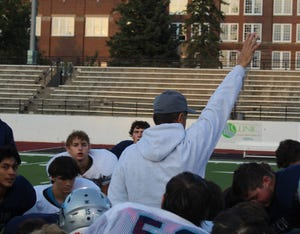 Mark Samson, head football coach at Great Falls High, addresses his players after their scrimmage Friday night at Memorial Stadium. The Bison open their 2021 season next Friday at the Stadium against Helena High.