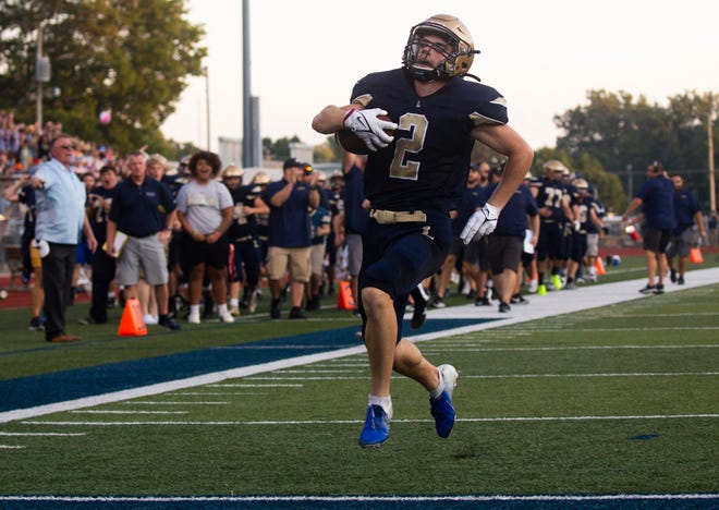 Lancaster's Brysten Poe (2) runs the ball in for a touchdown as they took on Pickerington North in high school football at Lancaster High School in Lancaster, Ohio on August 20, 2021.