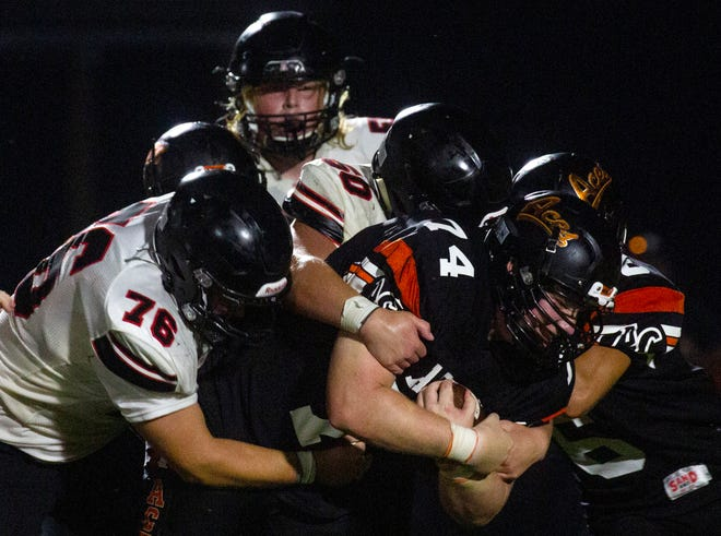 Amanda-Clearcreek's Darren Byers (74) tries to gain yardage after picking up a fumble as they took on Jonathan Alder in high school football last Amanda-Clearcreek High School in Amanda, Ohio on August 20, 2021.