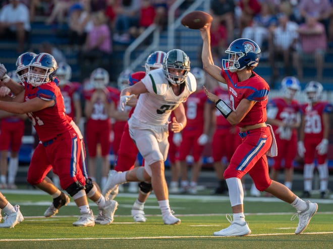 Christian Academy of Louisville quarterback Cole Hodge gets off a pass during first half action against South Oldham. Aug. 20, 2021