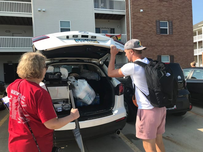 Thomas Buckles, 19, of Lyndhurst, a sophomore at OSU Mansfield, gets some help from his mom Francie Saturday during Move In Day at Buckeye Village Apartments. He is studying sports management.