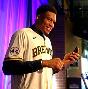 Bucks star Giannis Antetokounmpo dons a  Brewers during the announcement he would become an investor in the team on Friday.