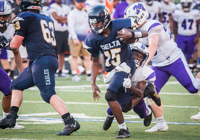 Delta's Kaiden Bond runs the ball against Muncie during their game at Delta High School Friday, Aug. 20, 2021.