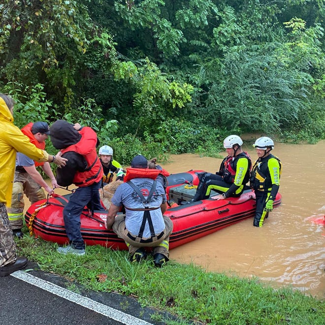 Dickson County emergency workers performed water rescues Saturday morning after inches of rain fell upon the area.