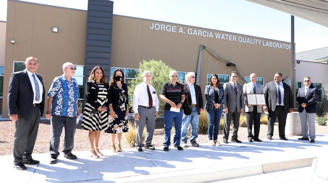 Local dignitaries gather outside the newly named Jorge A. Garcia Water Quality Laboratory, which honors the former director who has overseen much of the progress for the utility over his 30-year career at the City.