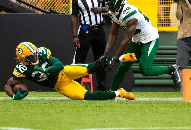 Green Bay Packers running back Kylin Hill (32) scores a touchdown in the first quarter against the New York Jets during their preseason game on Saturday at Lambeau Field in Green Bay.