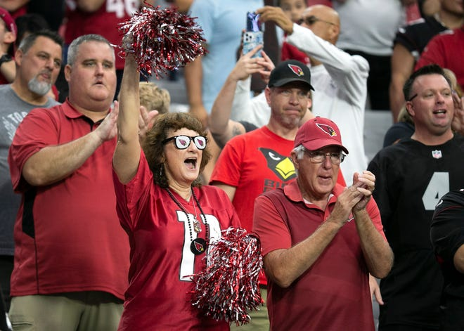 Cardinals fans cheer at the start of the preseason game against the Chiefs at State Farm Stadium in Glendale on August 20, 2021.