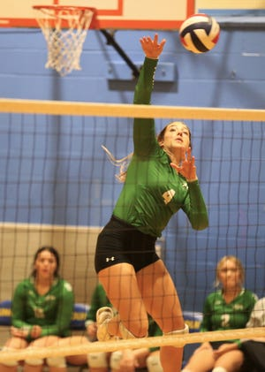 Wall High School's Kamryn Williams goes up high for a kill attempt during a pool-play match against Del Rio at the Nita Vannoy Memorial Volleyball Tournament at Lincoln Middle School on Friday, Aug. 20, 2021.