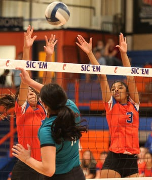 San Angelo Central High School's Peyton Mayberry, far right, and a teammate try to block a shot during a pool-play match against El Paso Pebble Hills at the Nita Vannoy Memorial Volleyball Tournament at Babe Didrikson gym on Friday, Aug. 20, 2021.