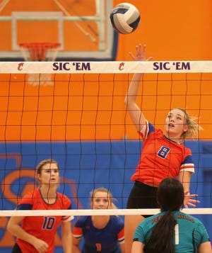 San Angelo Central High School's Morgan Strain, 8, goes up for an attack during a pool-play match against El Paso Pebble Hills at the Nita Vannoy Memorial Volleyball Tournament at Babe Didrikson gym on Friday, Aug. 20, 2021.