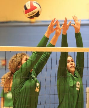 Wall High School's Caroline Holtman, 12, and Erin Morrison try to block a shot during a pool-play match against Del Rio at the Nita Vannoy Memorial Volleyball Tournament at Lincoln Middle School on Friday, Aug. 20, 2021.