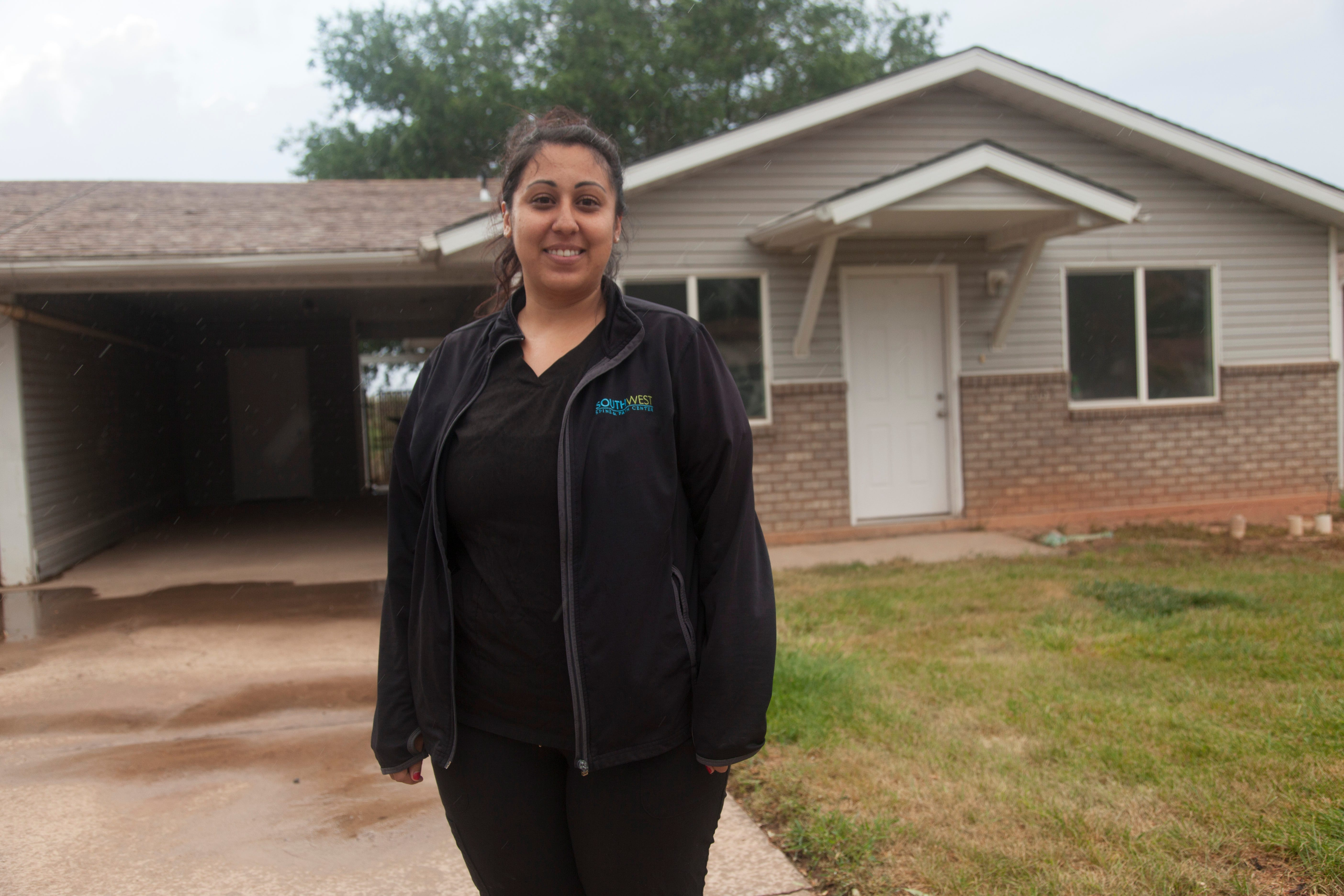 Samantha Tom discusses her housing situation in Cedar City on Aug. 18.