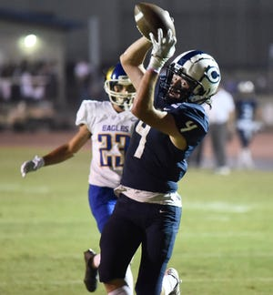 Josh Noeske grabs the ball for the first touchdown during a non-league high school football game between Central Valley Christian and Bakersfield Christian in Visalia on August 20, 2021