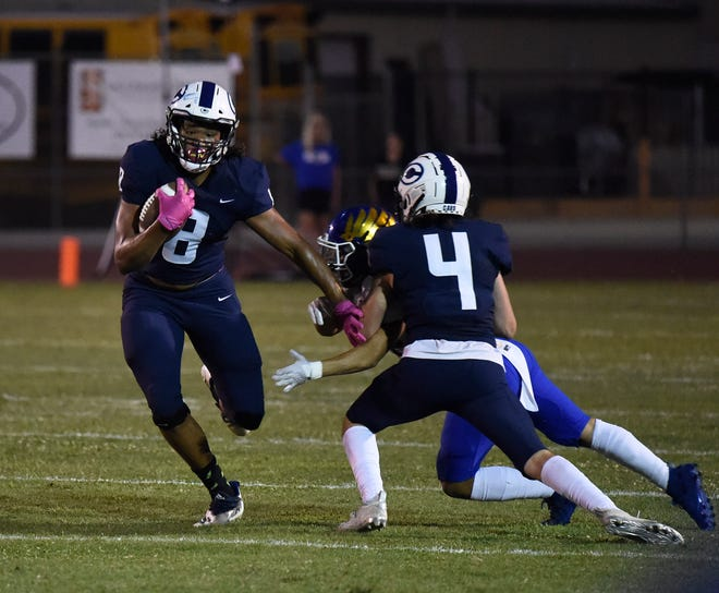 Jaeden Moore gets tackle assistants from Josh Noeske during a non-league high school football game between Central Valley Christian and Bakersfield Christian in Visalia on August 20, 2021
