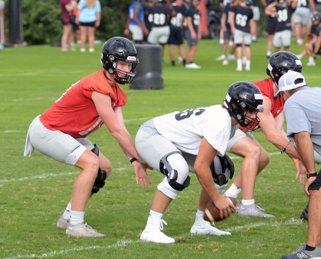 Lake Travis junior quarterback Bo Edmundson, taking a snap during the team's first preseason practice, is focused on helping the Cavaliers erase the memory of 2020's first round playoff exit.