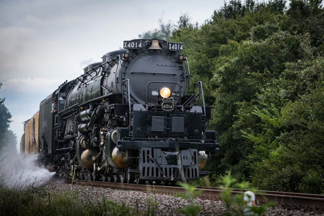 """The 4014 the only operating """"Big Boy,"""" which are the biggest steam engines ever built. Only one of these 1930s locomotives runs actively on tracks. When it roared through Texas recently on a Union Pacific public tour, crowds of train fans met it at every stop."""