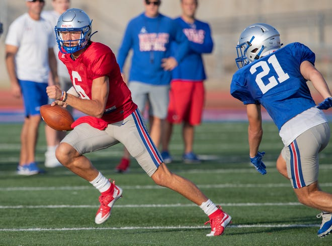 Westlake quarterback Cade Klubnik scrambles during a recent intrasquad scrimmage at Chaparral Stadium. Klubnik is the first five-star quarterback recruit from the Austin area since Garrett Gilbert of Lake Travis in 2009.