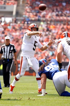 Cleveland Browns quarterback Case Keenum (5) throws a pass during an NFL football game agains the New York Giants , Sunday, Aug. 22, 2021, in Cleveland. (AP Photo/Kirk Irwin)
