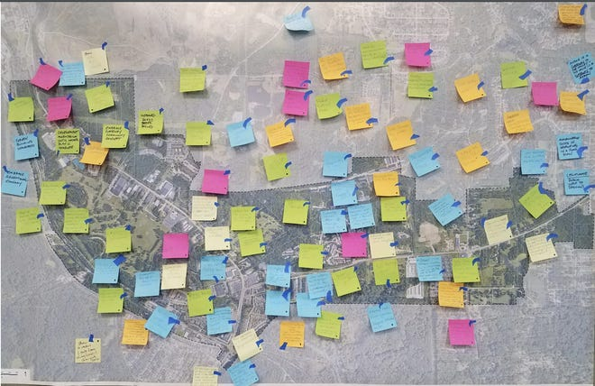 Post-it Notes with public comments are stuck to a map of the Merriman Valley and Schumacher Area, where the cities of Akron and Cuyahoga Falls are designing a master plan for future development.