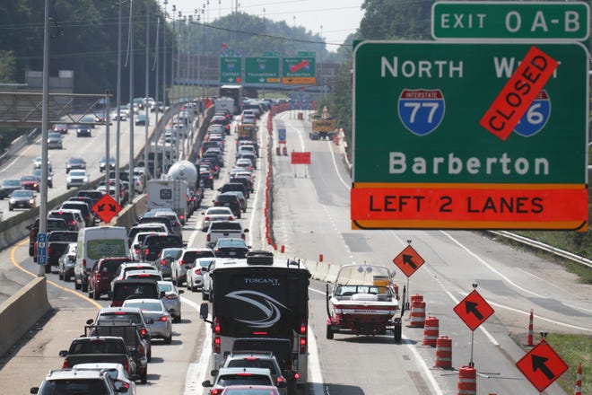 State Route 8 southbound back ups Sunday heading into the Central Interchange in Akron. The Carroll Street ramp onto Route 8 southbound closed. Traffic at noon was backed up over a mile from beyond Perkins Street exit to the Central Interchange.