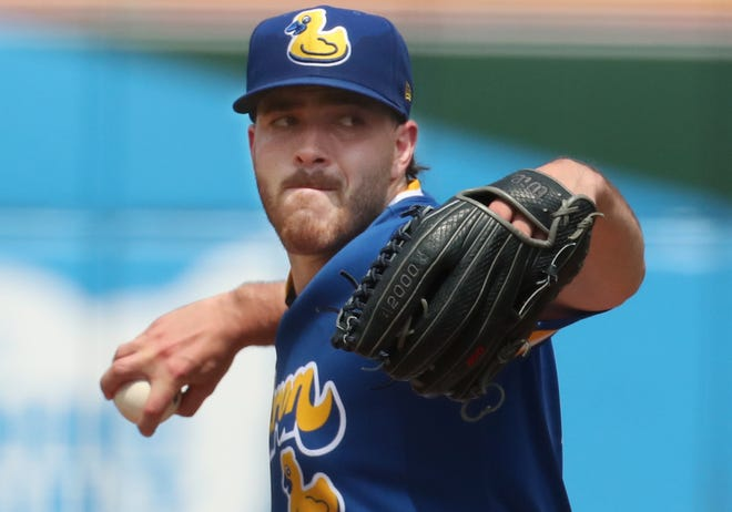 Cleveland starter Aaron Civale, on a rehab assignment with the RubberDucks, pitches against the Harrisburg Senators in the first inning on Sunday at Canal Park. [Mike Cardew/Beacon Journal]