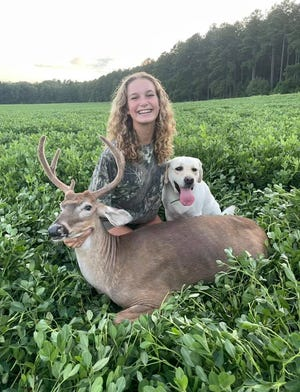 Out-of-state hunter Mya Bridgewater and her four-legged hunting companion proudly display her first deer, a hefty five-point killed in Hampton County and processed by Wayne's Deer Processing in the southern portion of the county.