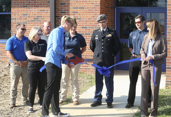 Boonville High School Student Body President Gabe Brimer cuts the ribbon for the new connector between Boonville High School and B-Tech Thursday night. The two-year project was part of the Phase 1 project.